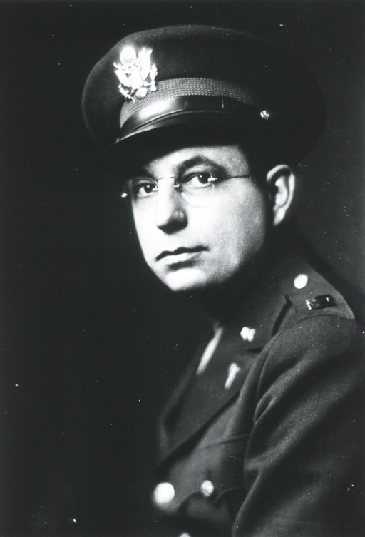 <p>Head and shoulders, left pose, full face; wearing glasses, uniform and cap (Captain).</p>