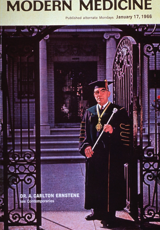 <p>Full length, standing in cap and gown, holding a mace.</p>
