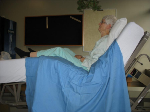Older adult sitting in a high Fowler's position. | Open-i