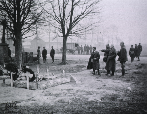 <p>Secretary Baker paying respects at graves of American soldiers of 165th Inf. killed in action.</p>