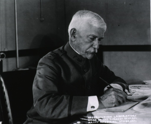 <p>Half-length, right pose; wearing uniform; seated at desk; writing.</p>