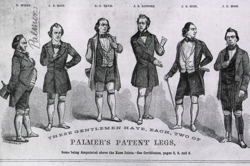 <p>Full length view of six men, all double amputees with artificial legs.</p>