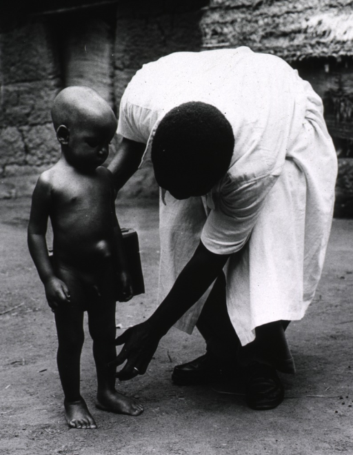 <p>Exterior view: a physician is examining a young boy.</p>