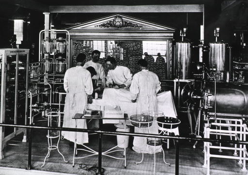 <p>View of U.S. Public Health and Marine Service exhibit  depicting doctors performing surgery in a Marine Hospital operating room; at the Jamestown Ter-centennial Exposition, probably part of the Army and Navy Exhibits in the Government Building, West.</p>