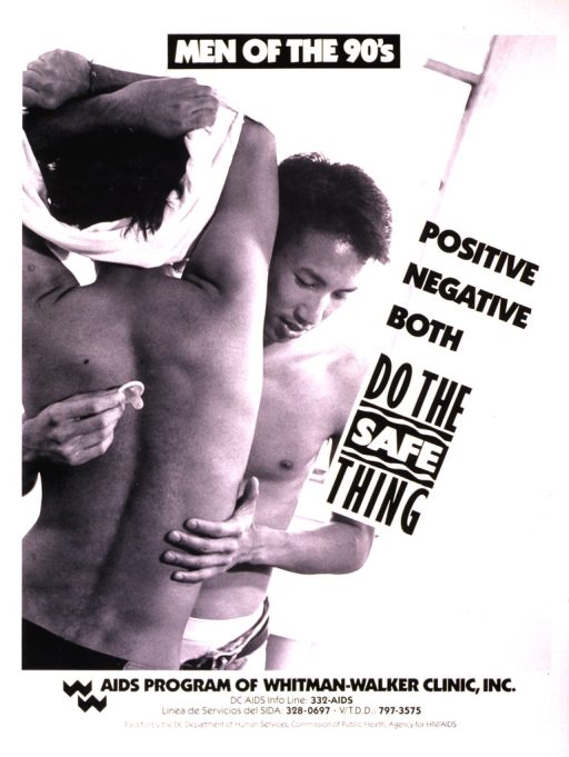 <p>View from the waist up of two young men embracing, one of them is holding a condom.</p>