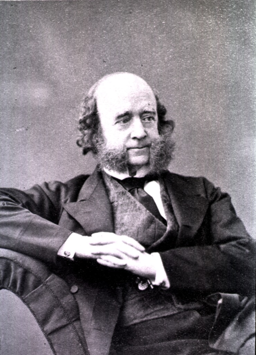 <p>Half-length, seated, right pose, hands together, right elbow resting on back of chair.</p>