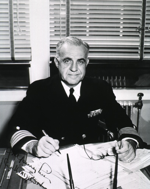 <p>Half length, full face, seated at desk, uniform (Capt.).</p>