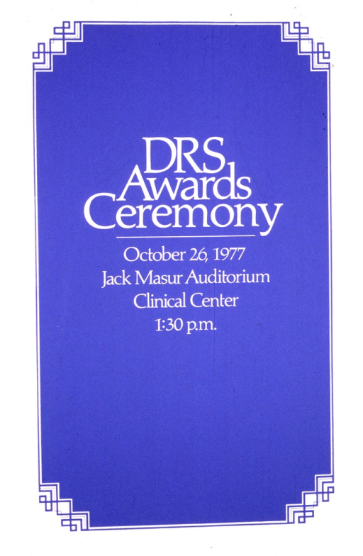 <p>Poster announcing an awards ceremony to be held on October 26, 1977.  The poster is text only, written on a blue background with a white border.</p>