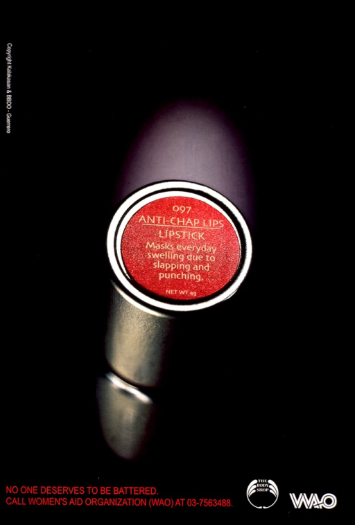 <p>Predominantly black poster with multicolor lettering.  Visual image is a reproduction of a color photo of a lipstick tube.  Title on tube cap, at center of poster.  Caption in lower left corner.  Sponsor and publisher logos in lower right corner.</p>