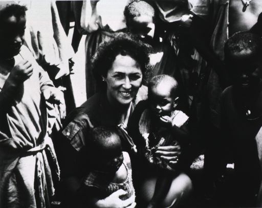 <p>A PHS nurse is shown with Tigrean refugee children at a reception area near the Ethiopian border.</p>