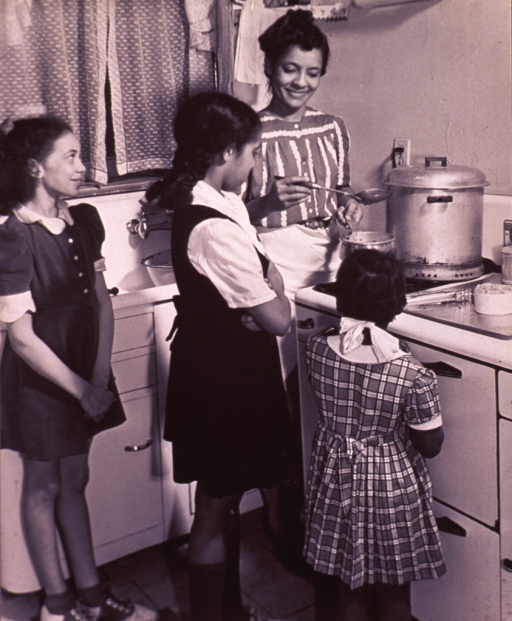 <p>Children are helping their mother with the cooking.</p>