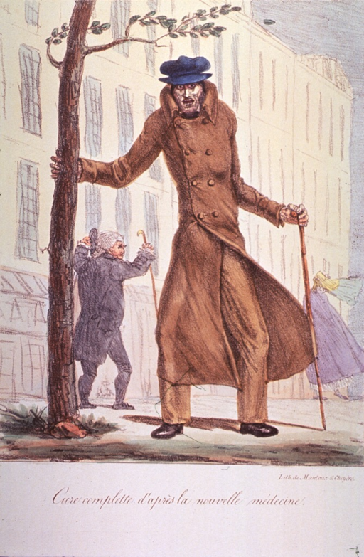 <p>A man wearing a coat and hat, holding a cane in one hand and holding on to a tree to steady himself against the wind; in the background a man and a woman struggle against the wind.</p>
