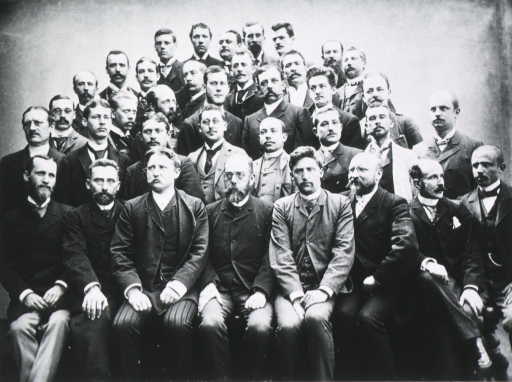 <p>Large group, Koch seated middle of front row.</p>
