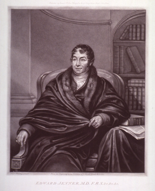 <p>Three-quarter length, seated, full face; wearing robe; bookshelves in background.</p>