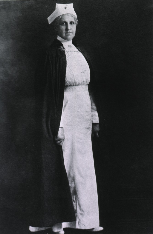 <p>Full length, full face, wearing Red Cross uniform.</p>