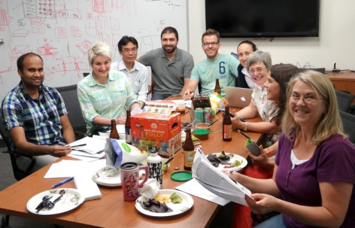 Schmid (third from right) and current lab members at journal club actively discussing the newest papers, their merits and shortcomings, and the new experiments they suggest.