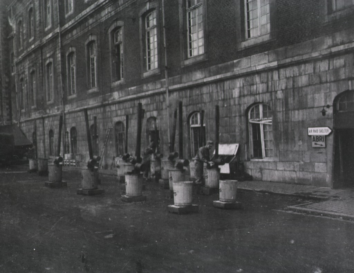 <p>A serviceman is shown standing next to one of the immersion heaters that are positioned on the street in front of the hospital.</p>