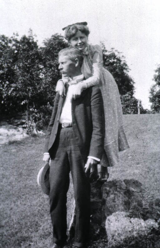 <p>Standing by rock, with his daughter Blossom - arms around his neck.</p>