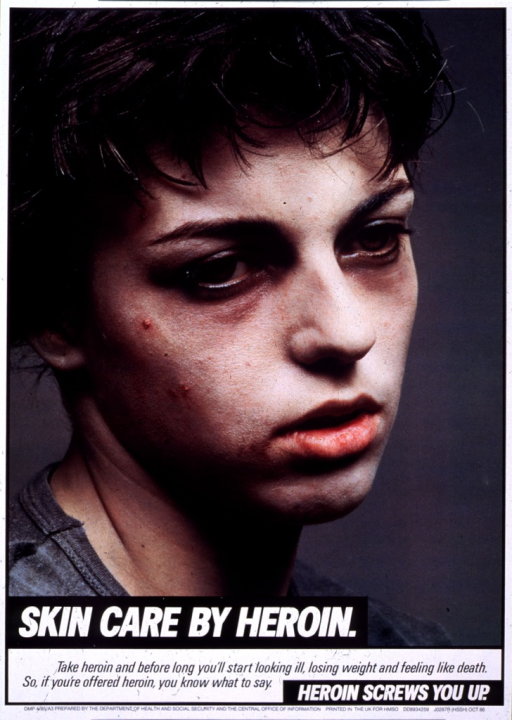 <p>Poster features photo image of the head and shoulders of a dark-haired young man with dark circles under his eyes, acne, and scaly skin on his face.  Title text is white lettering on offset black rectangles.  Caption text is black lettering on white background.  Entire poster has white border.</p>