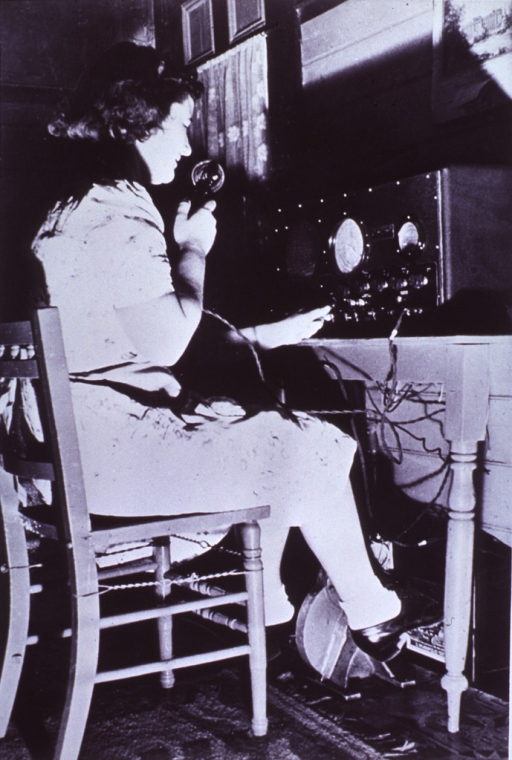 <p>A radio operator is using a transceiver set near Broken Hill, Pincally Station, Australia, to call a &quot;flying doctor.&quot;</p>