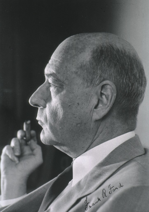 <p>Head and shoulders, left profile, holding cigar.</p>
