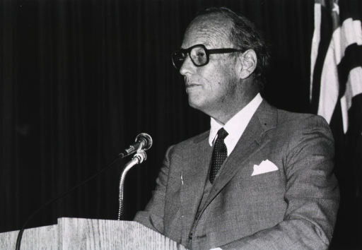 <p>Donald S. Fredrickson, director of the National Institutes of Health, is standing in front of a microphone at a podium.</p>