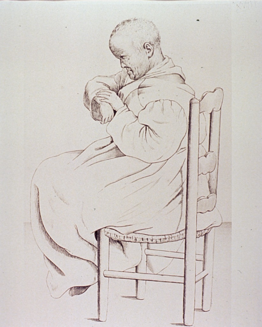 <p>An old male inmate sits on a chair, looking at his wrist.</p>
