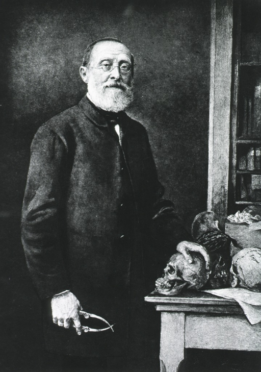<p>Standing, three quarter length; right pose; face front.  One hand on skull on table, other holding forceps.</p>
