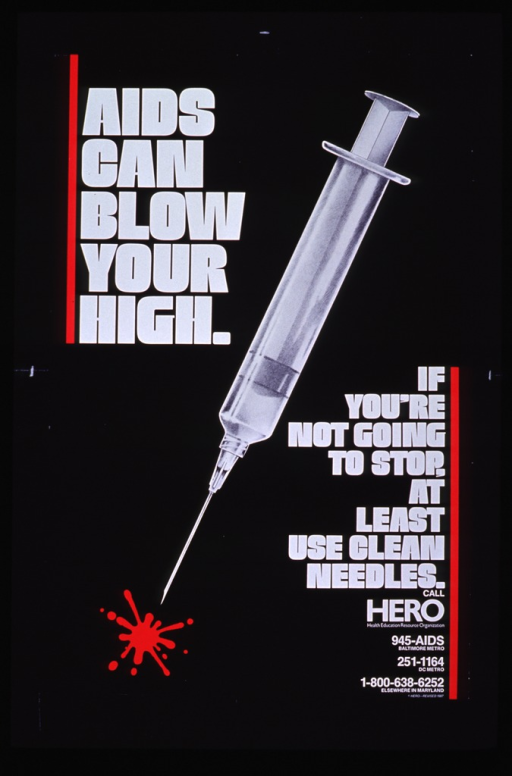 <p>Black background with a grey hypodermic needle and a splatter of blood below the needle.</p>