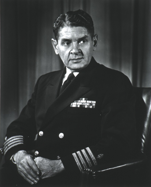 <p>Half-length, seated, left pose, full face; wearing U.S. Navy uniform; hands together in front.</p>