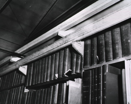 <p>Interior view: Molding that runs across the top shelf shows the damage as a result of a leaking roof.</p>