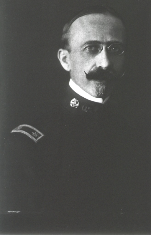 <p>Head and shoulders, right pose, full face; wearing uniform and glasses.</p>