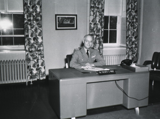 <p>Half length, seated at desk, full face, uniform (Capt.).</p>