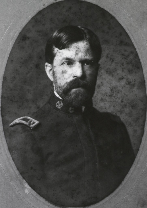 <p>Head and shoulders, right pose, full face; wearing uniform; in oval.</p>