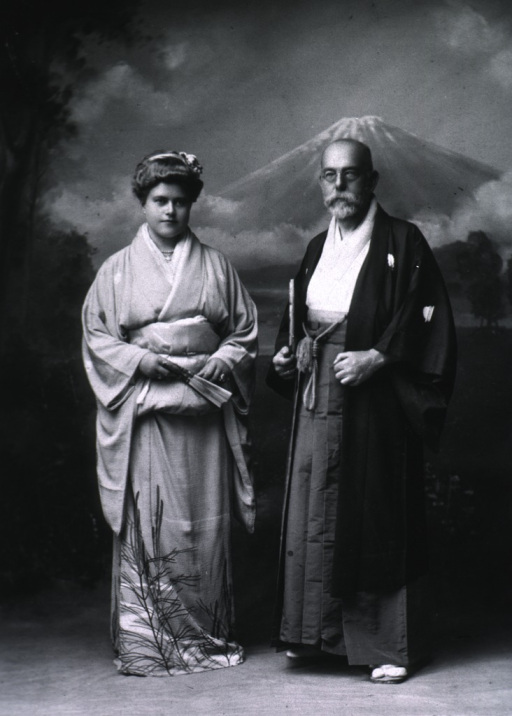 <p>Full length, standing, with Mrs. Koch; wearing Japanese dress.</p>