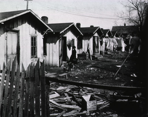 <p>Showing a nurse outside the shack of a Mexican family in Oklahoma City.</p>