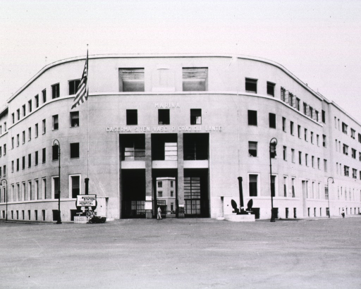 <p>Front view of the four-story building. Above the entrance appears the following:  Marina, Caserma S. Ten. Vasc. R. Grazioli Lante.</p>