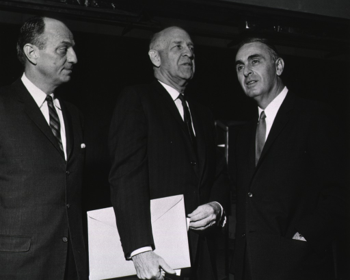 <p>Surgeon General Luther Terry, Senators Lister Hill, of Alabama, and Abraham Ribicoff, of Connecticut, are standing together.  Senator Hill is holding a large envelope.  Senator Ribicoff has one hand in his pocket.</p>