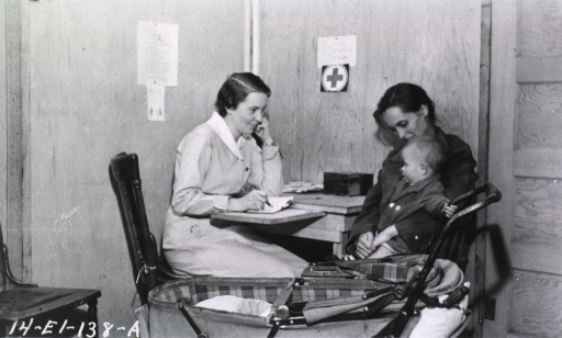 <p>Showing a nurse interviewing the mother in regards to feeding the infant.</p>