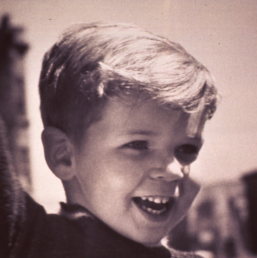<p>A child is smiling.</p>