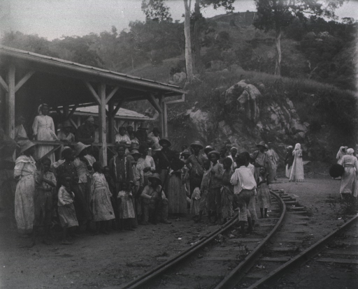 <p>View of refugees, mostly women and children, gathered outside a railroad station.</p>