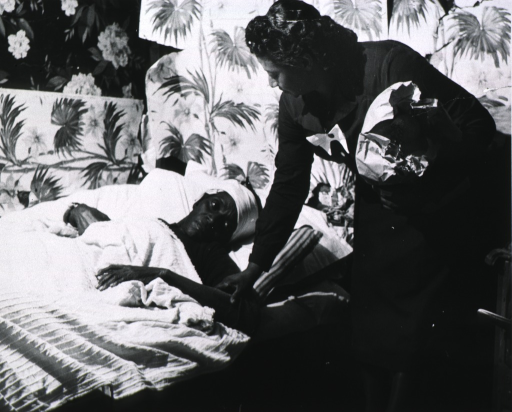 <p>Elderly African American patient receiving care from Eugenia Broughton.</p>