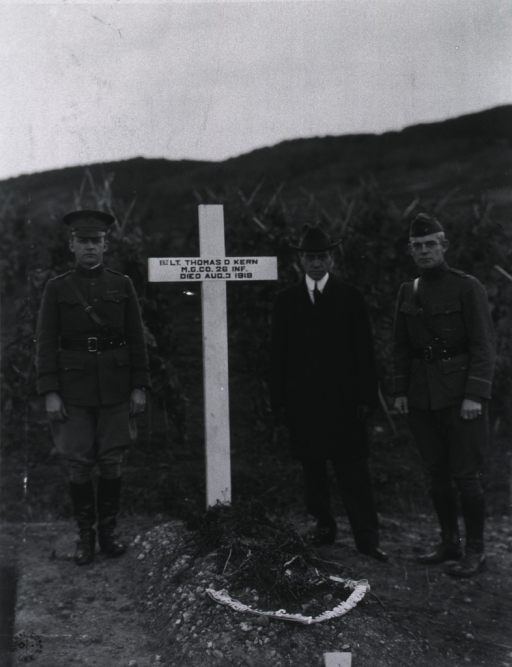 <p>At grave of 1st Lt. Thomas D. Kern, Chatel-Guyon, France.</p>