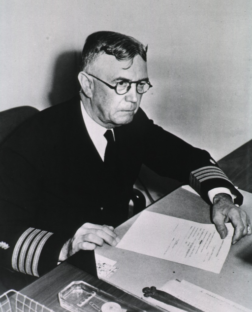 <p>Half length, right pose, seated at desk, in uniform.</p>
