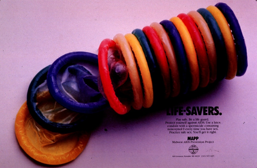 <p>Predominantly pale gray poster with black lettering.  Visual image is a color photo reproduction featuring a brightly colored stack of condoms.  Title, caption, and publisher information in lower right corner.</p>