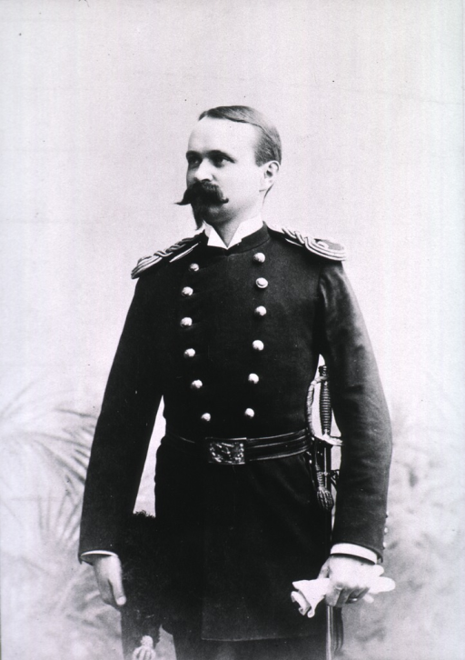 <p>Three-quarter length, standing, left pose, wearing dress uniform (Lieut.), holding gloves and sword.</p>