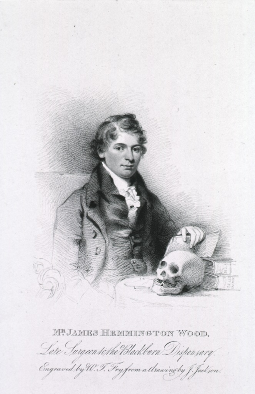 <p>Seated, face front with skull and books on table.</p>