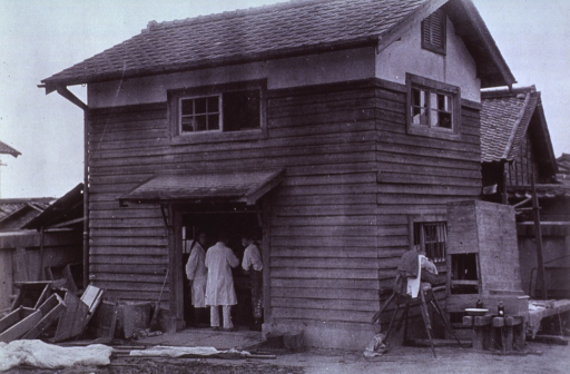 <p>Exterior view of the Kusatsu Primary School Temporary Hospital (5000 meters).  Necropsy Room was formerly a storeroom in corner of the school grounds.  The first necropsy was preformed here October 8, 1945.</p>