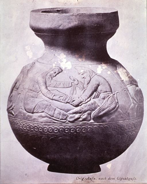 <p>Bandaging scene from an electrum vase of 4th century B.C., excavated at Koul-Oba in the Crimea.</p>