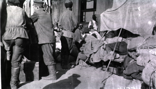 <p>Men wait outside at the railroad station in Harbin.</p>